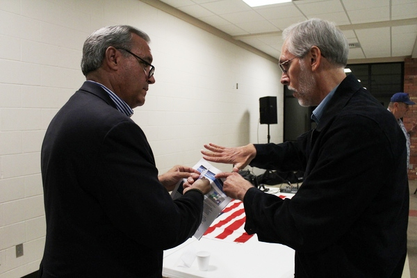 """Tim Porter of Pensacola (right) speaks to Congressman Jeff Miller (R-FL-1) about """"region-building,"""" Nov 11, 2013, in Pace, Florida. Photo: Mike Moring"""